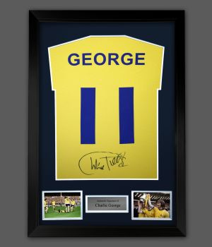 Charlie George Hand Signed Yellow Player  T-Shirt In A Framed Presentation