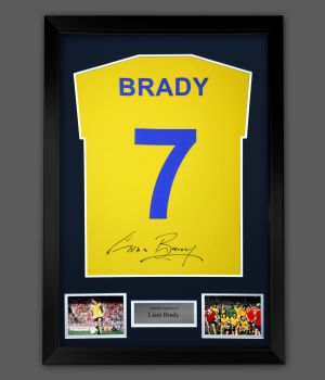 Liam Brady Hand Signed Yellow Player  T-Shirt In A Framed Presentation