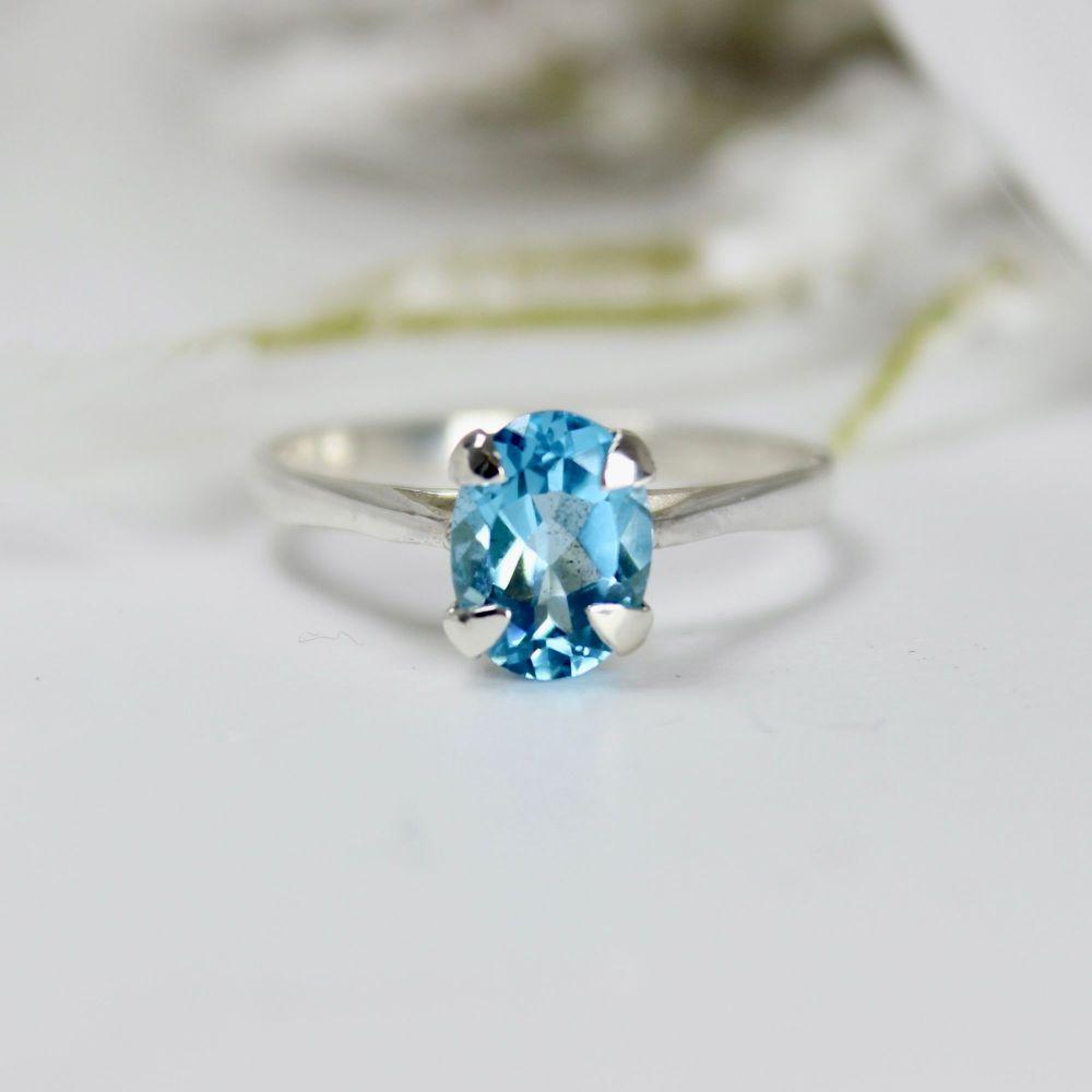 Swiss Blue Topaz Oval Stone Ring (8 x 6mm) - size M