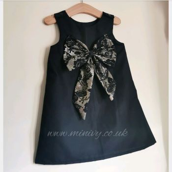 BLACK / GOLD SEQUIN BOW PINAFORE