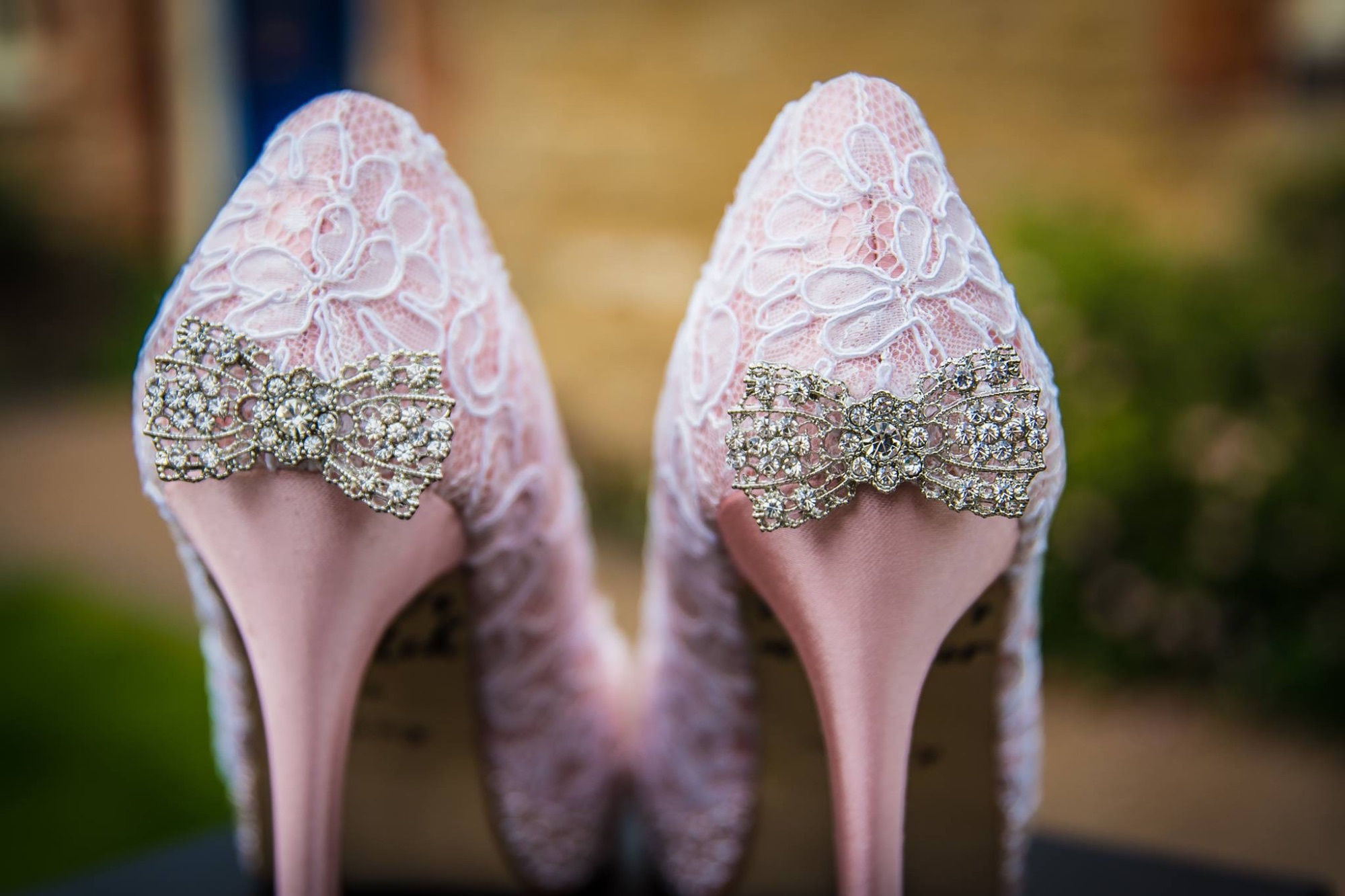 Lace and Love custom wedding shoes. Unique lace shoes with diamante bows.