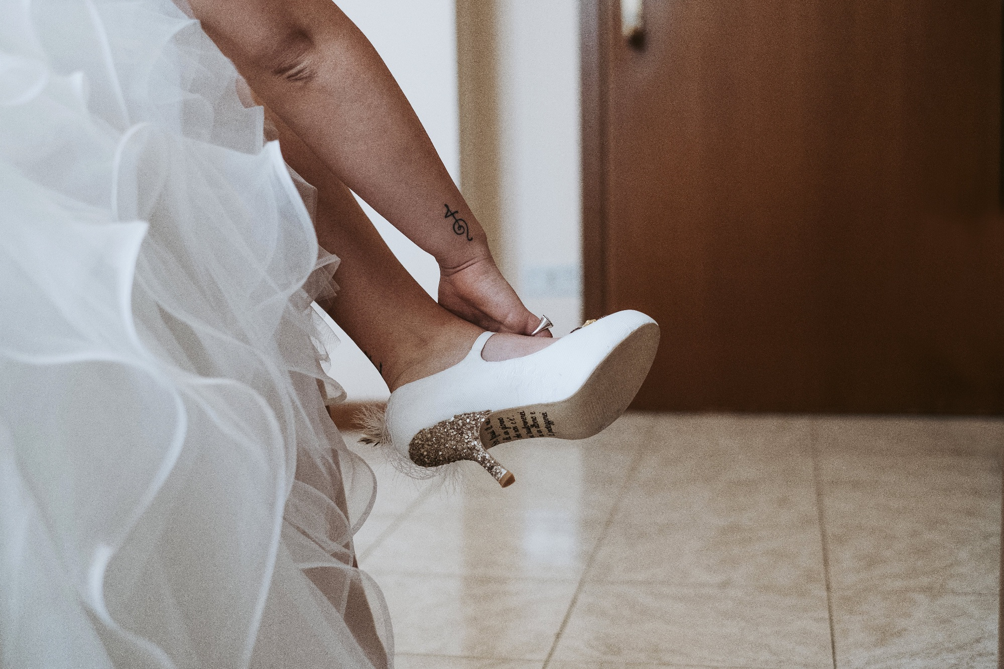 Customised wedding shoes with notes on the soles. Designed by Lace and Love