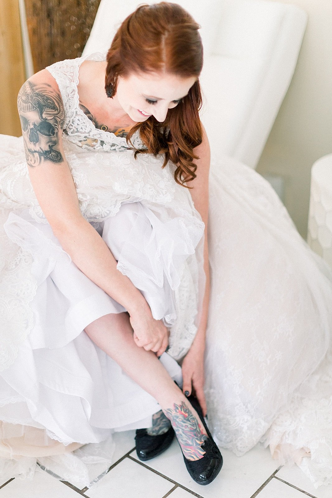 Alternative bride with black lace custom shoes and snakeskin