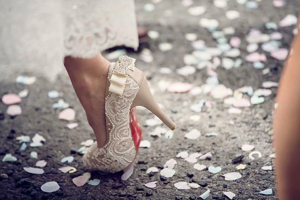 Unique lace wedding shoes by Lace and Love. Red soles