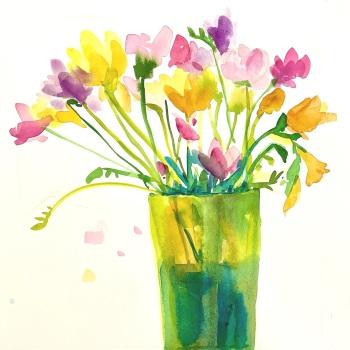 Freesias in a green vase