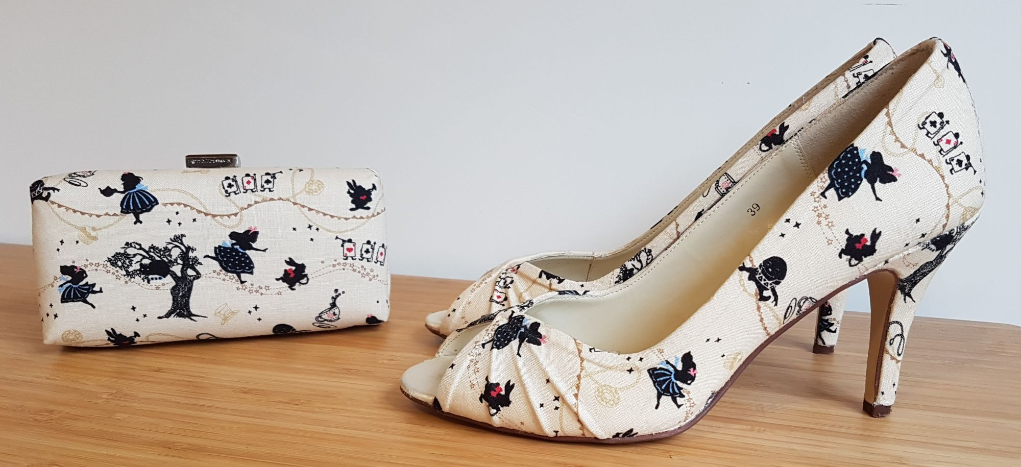Alice in Wonderland heels and clutch bag