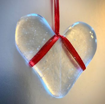Clear Glass Heart                             on red ribbon