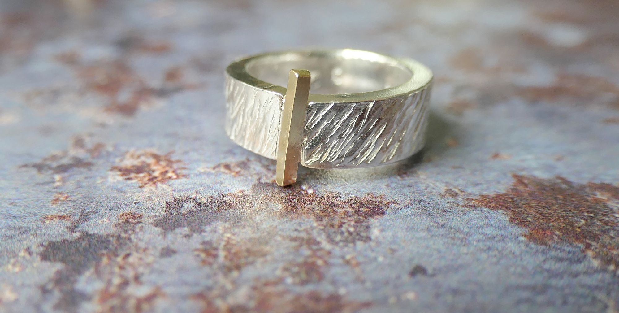 Silver and gold textured ring