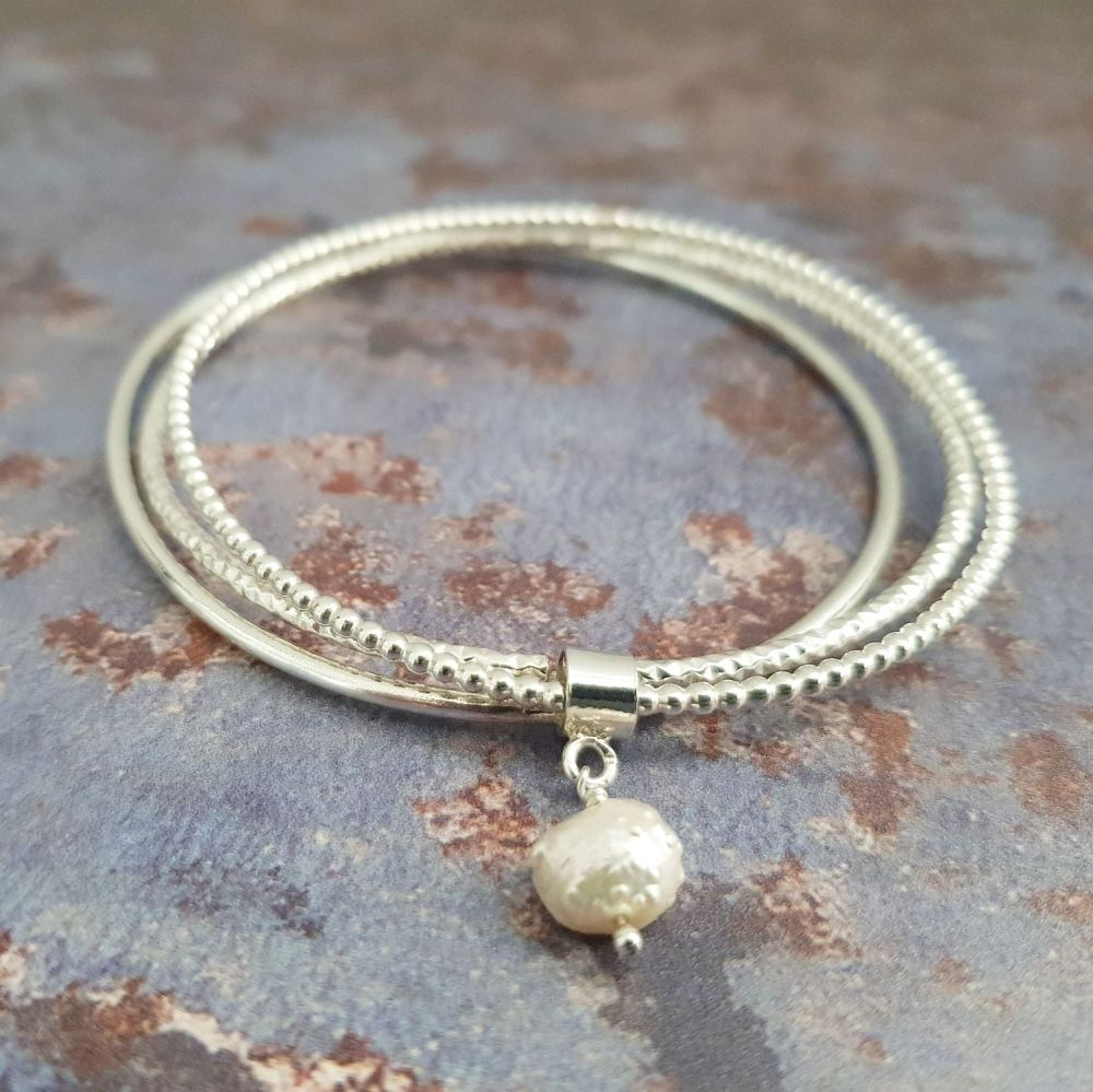 Sterling Silver stacking bangles with Baroque freshwater Pearl