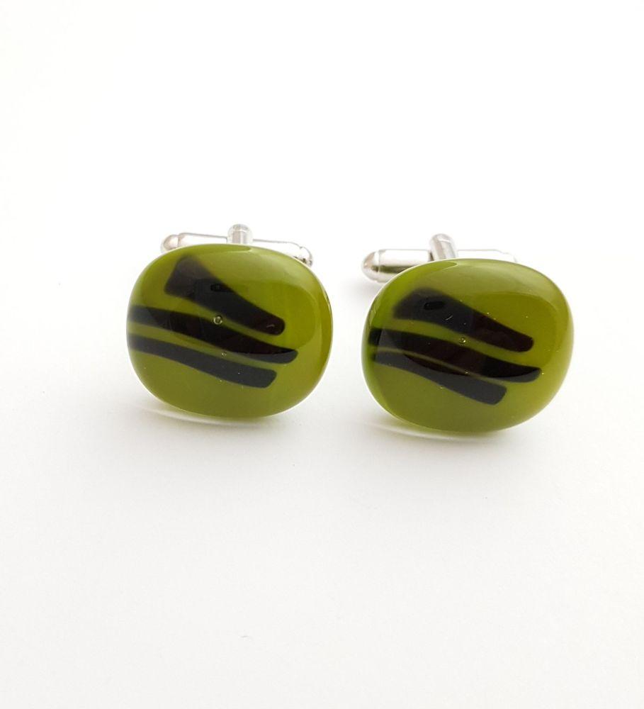 Avocado green cufflinks with black stripes