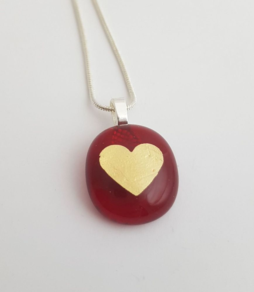 Small transparent red with gold mica heart