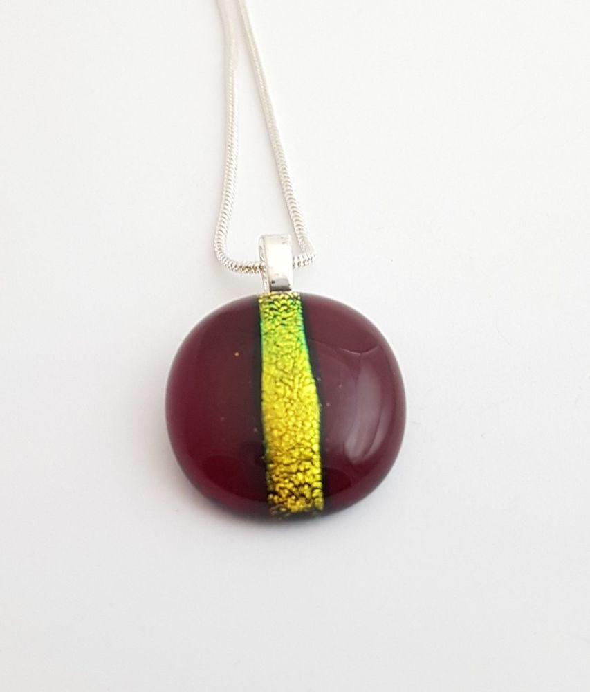 Garnet red with gold dichroic stripe