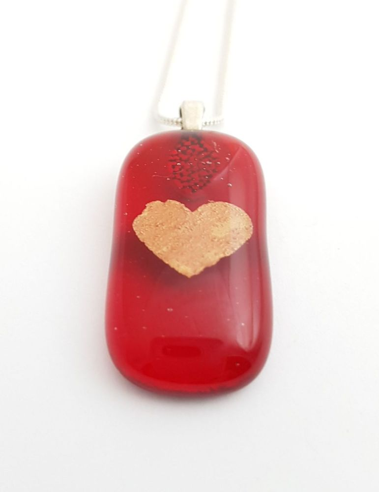 Transparent red with copper mica heart