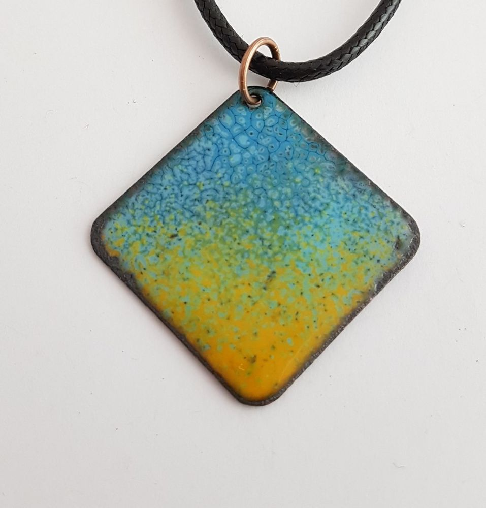 Teal blue pattern with apricot speckle necklace