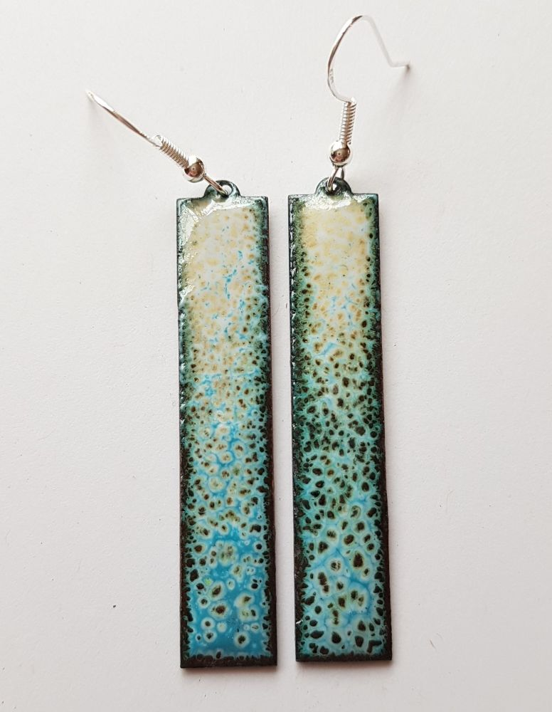 Ochre, turquoise and black speckled long earrings