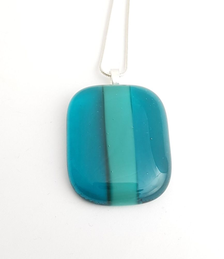 Peacock glass with teal stripe