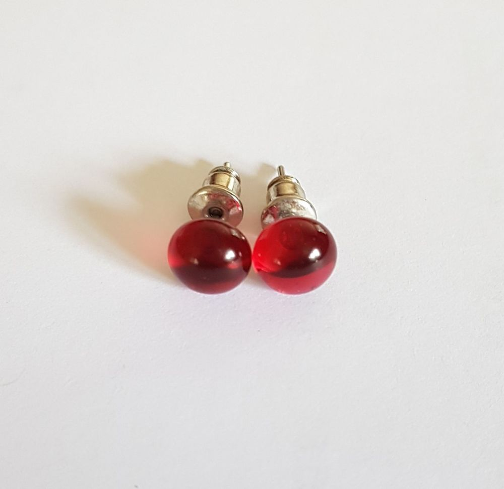 Cranberry pink transparent glass stud earrings