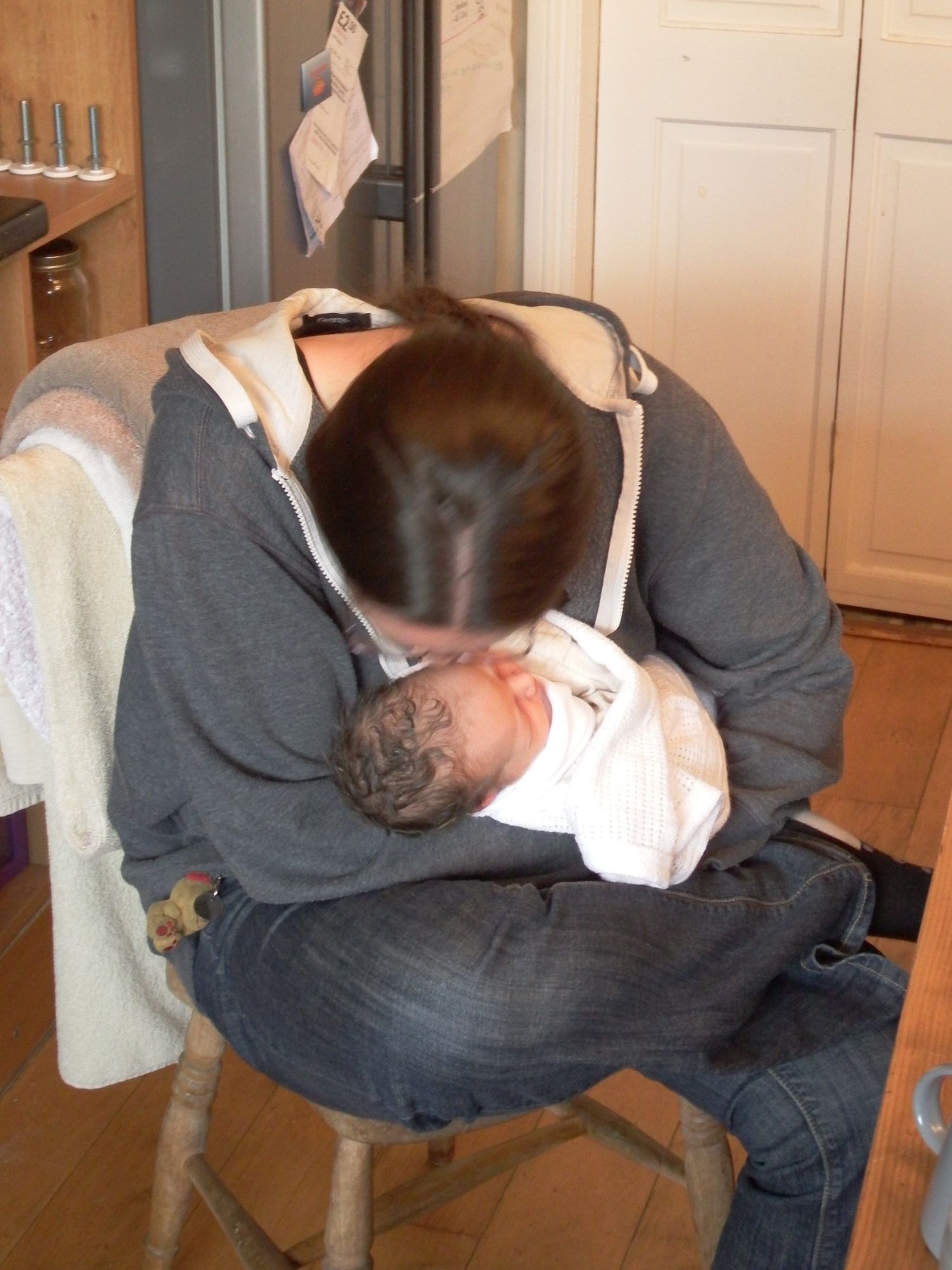 Caz smelling the top of a baby's head