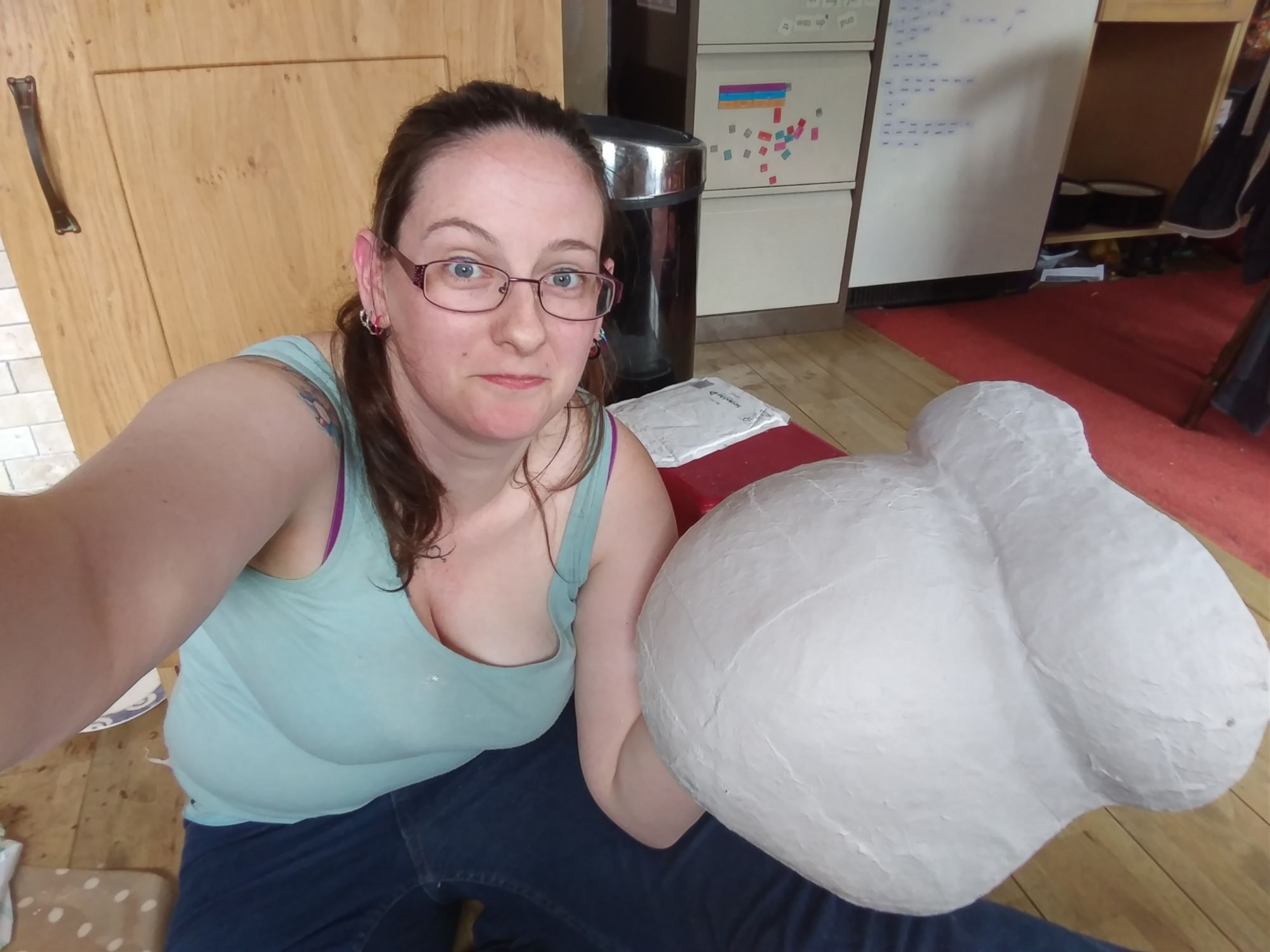 Caz holding a belly cast that has been sanded and had the edges trimmed.