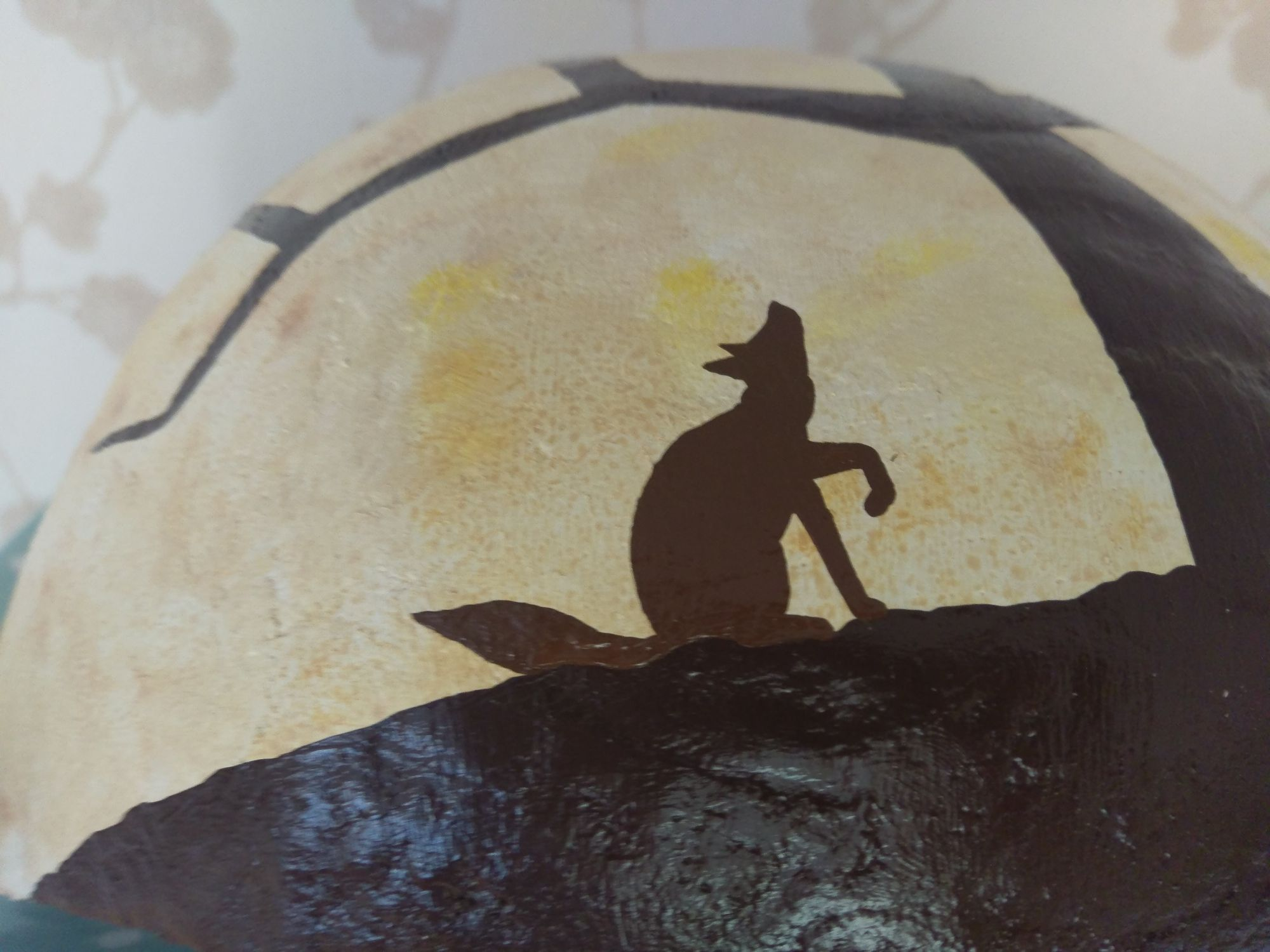 A close up of a fox silhouette painted on a bellycast.