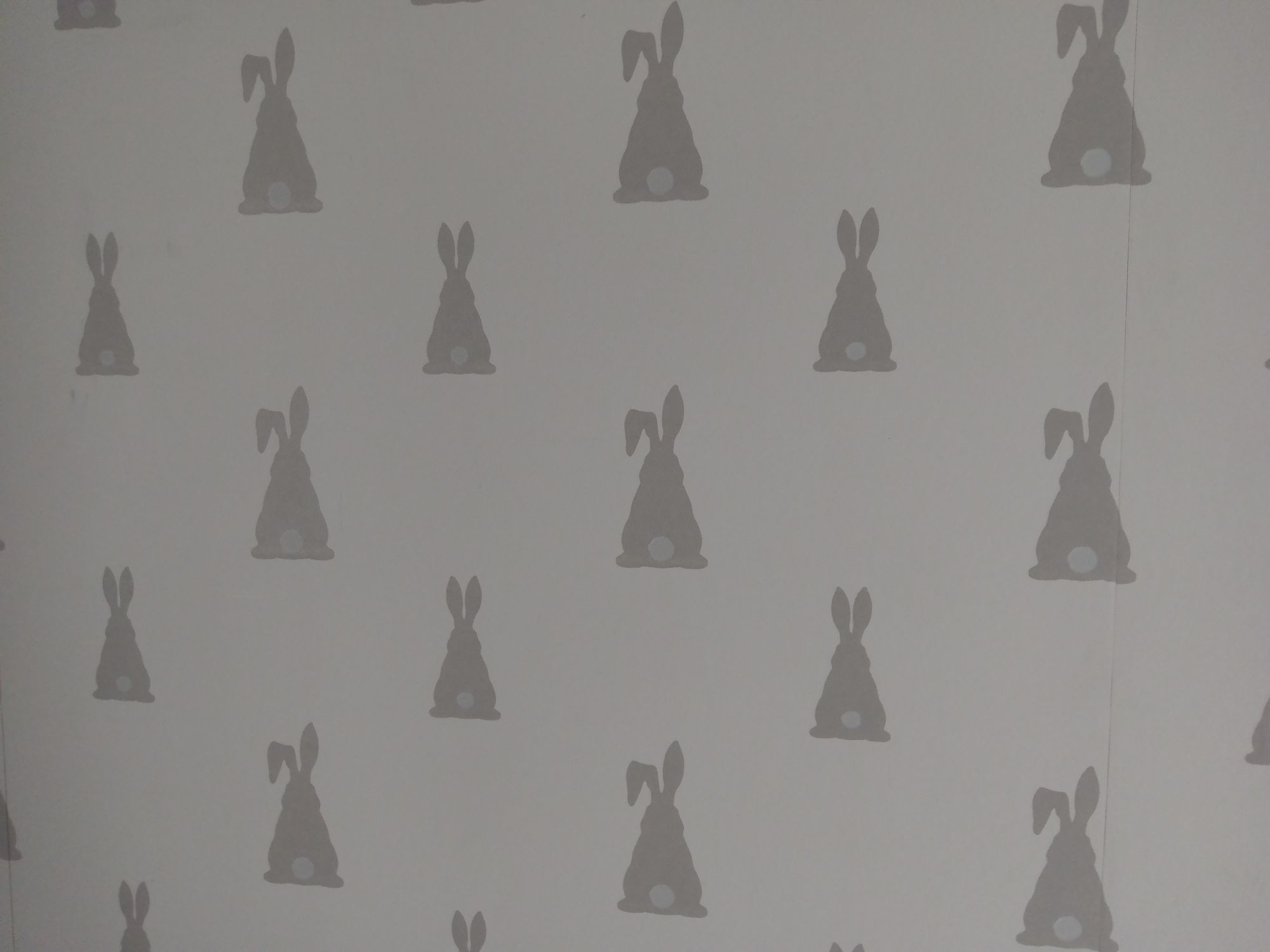 Inspiration: White wallpaper with grey rabbit silhouettes on it.
