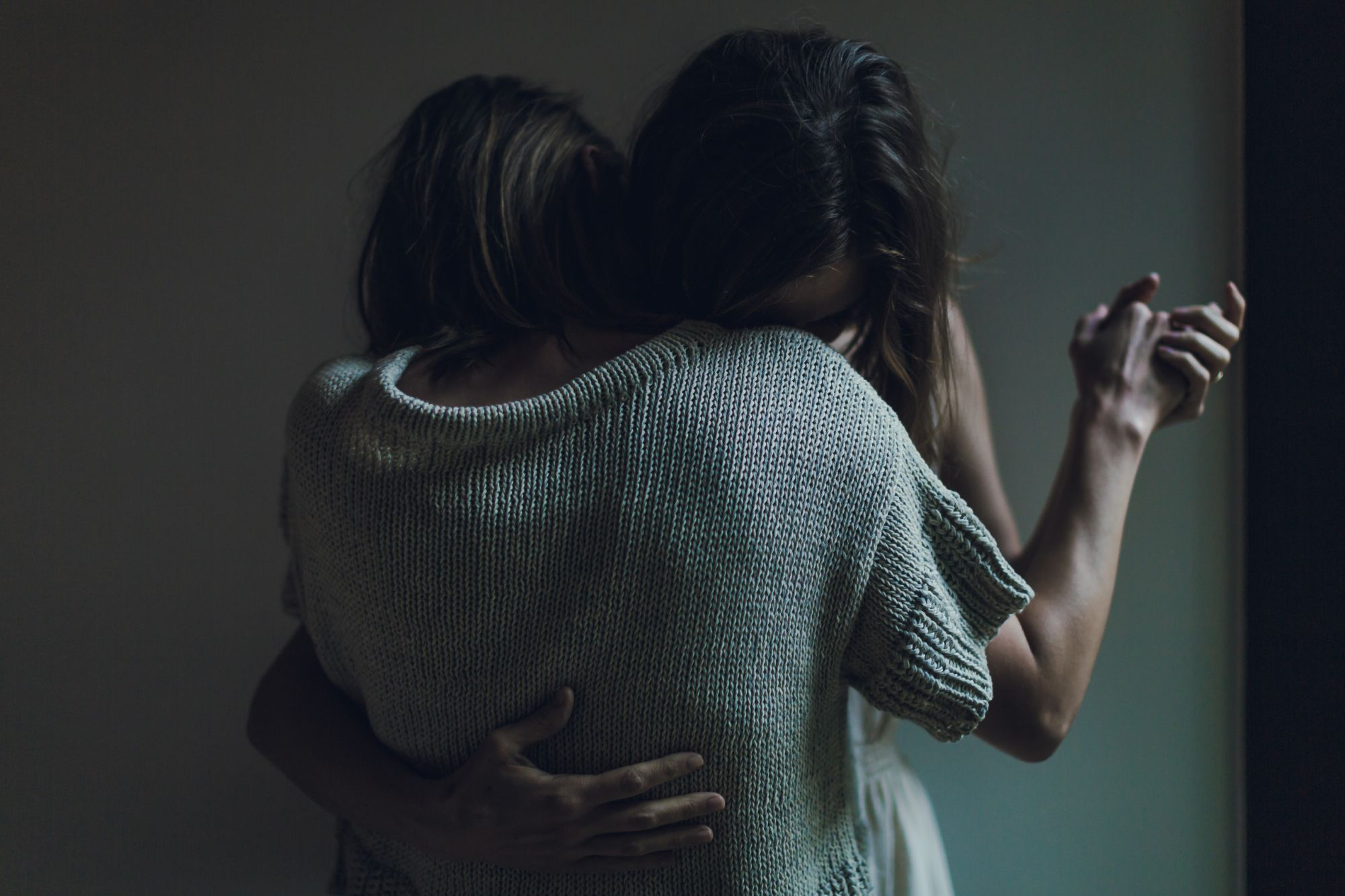 Image of two women embracing.