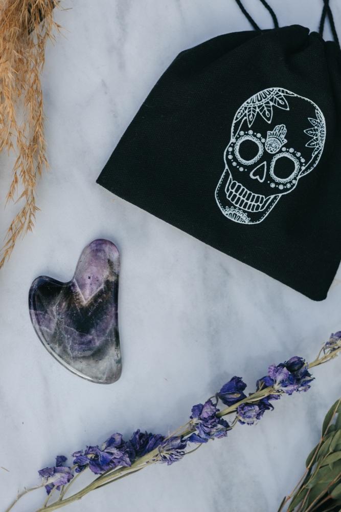 Amethyst Crystal Gua Sha with Black Skull Pouch
