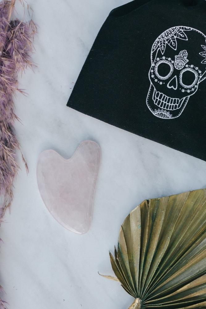 Rose Quartz Crystal Gua Sha with Black Skull Pouch