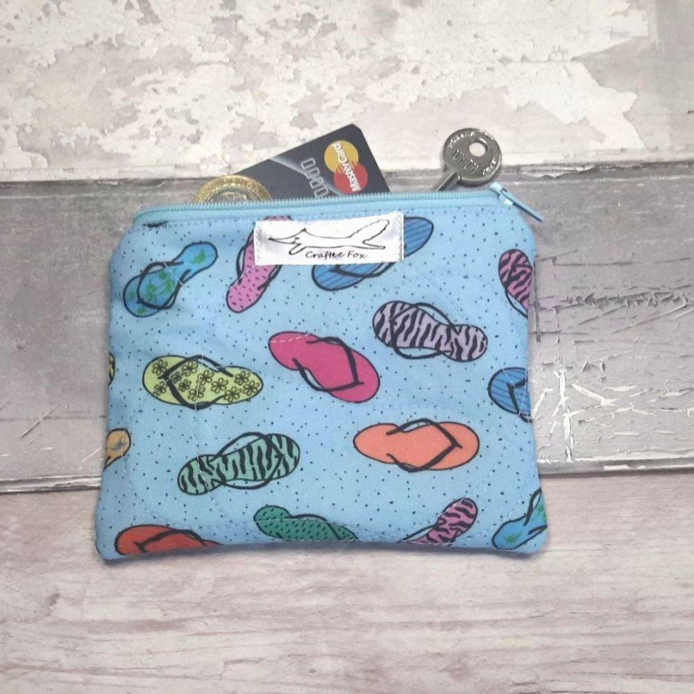 Small blue purse featuring flip flops