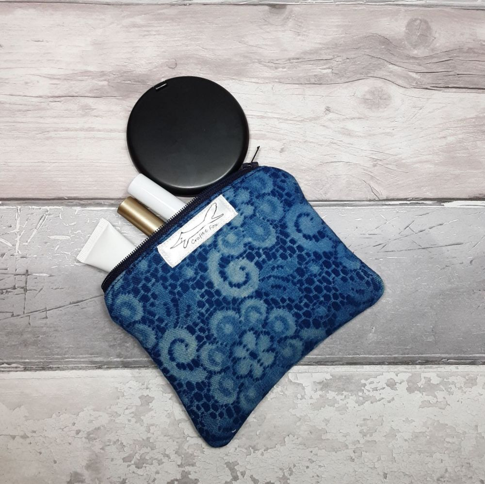Lacey patterened pouch