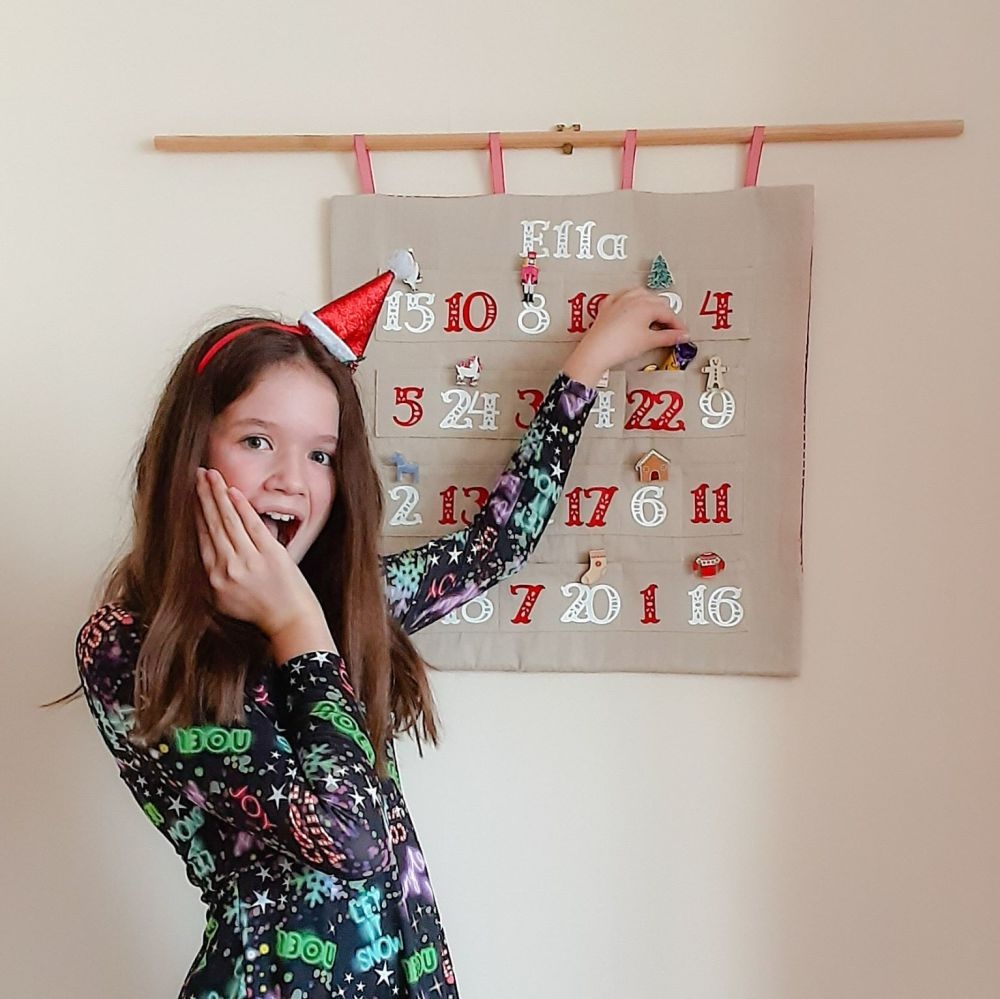 Organic fabric Advent Calendar with red and white numbers