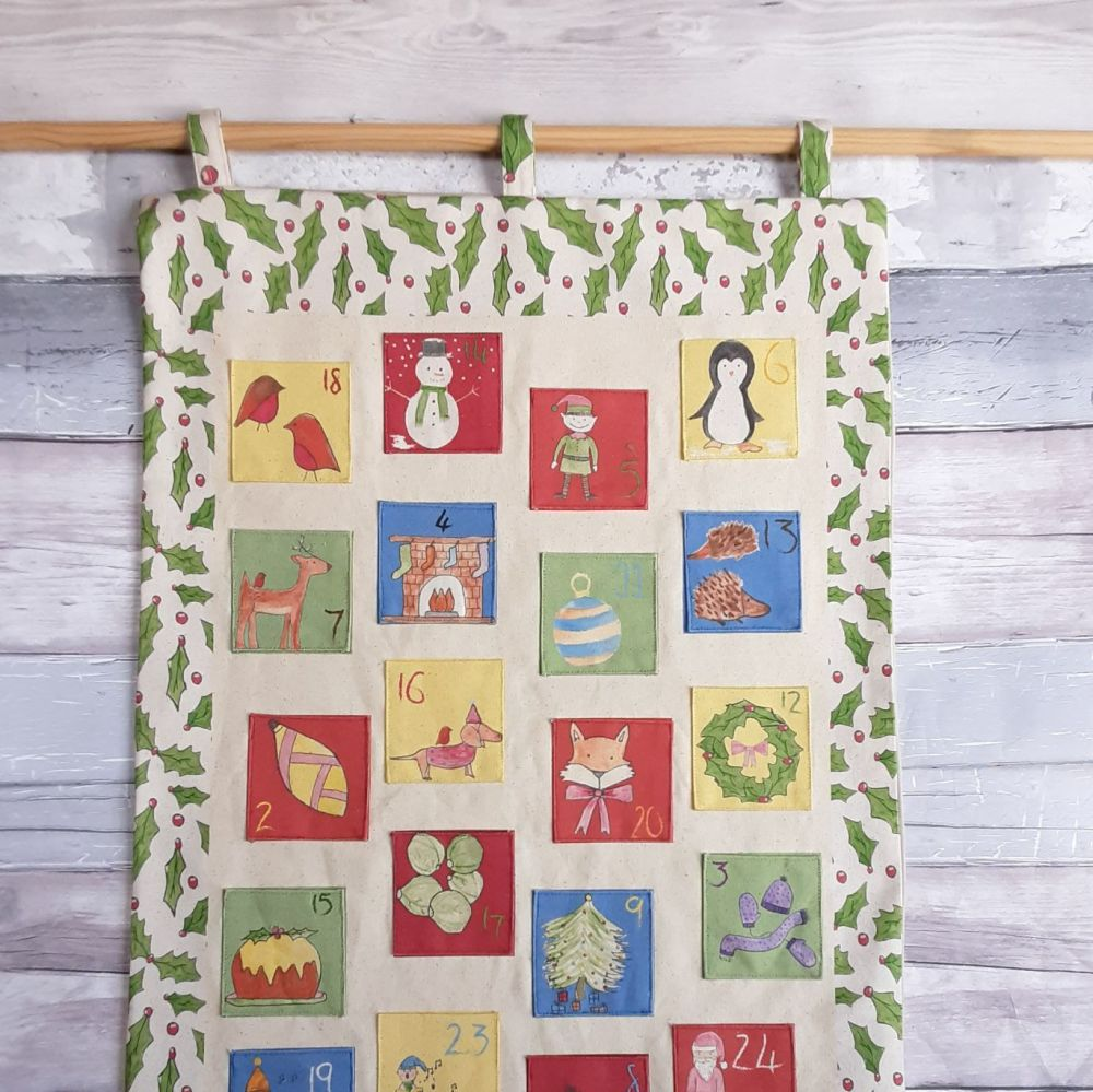 Cotton personalised Christmas advent calendar with holly design