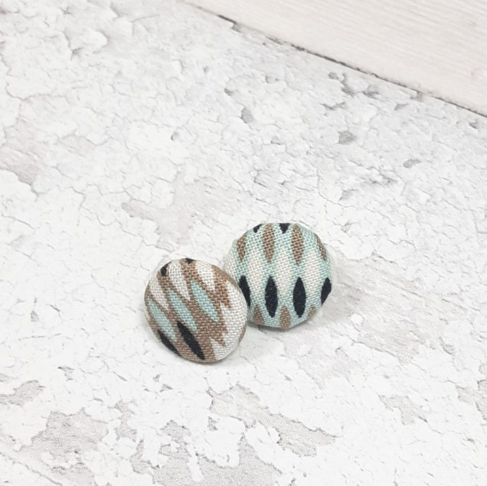 White, black and brown patterned earrings