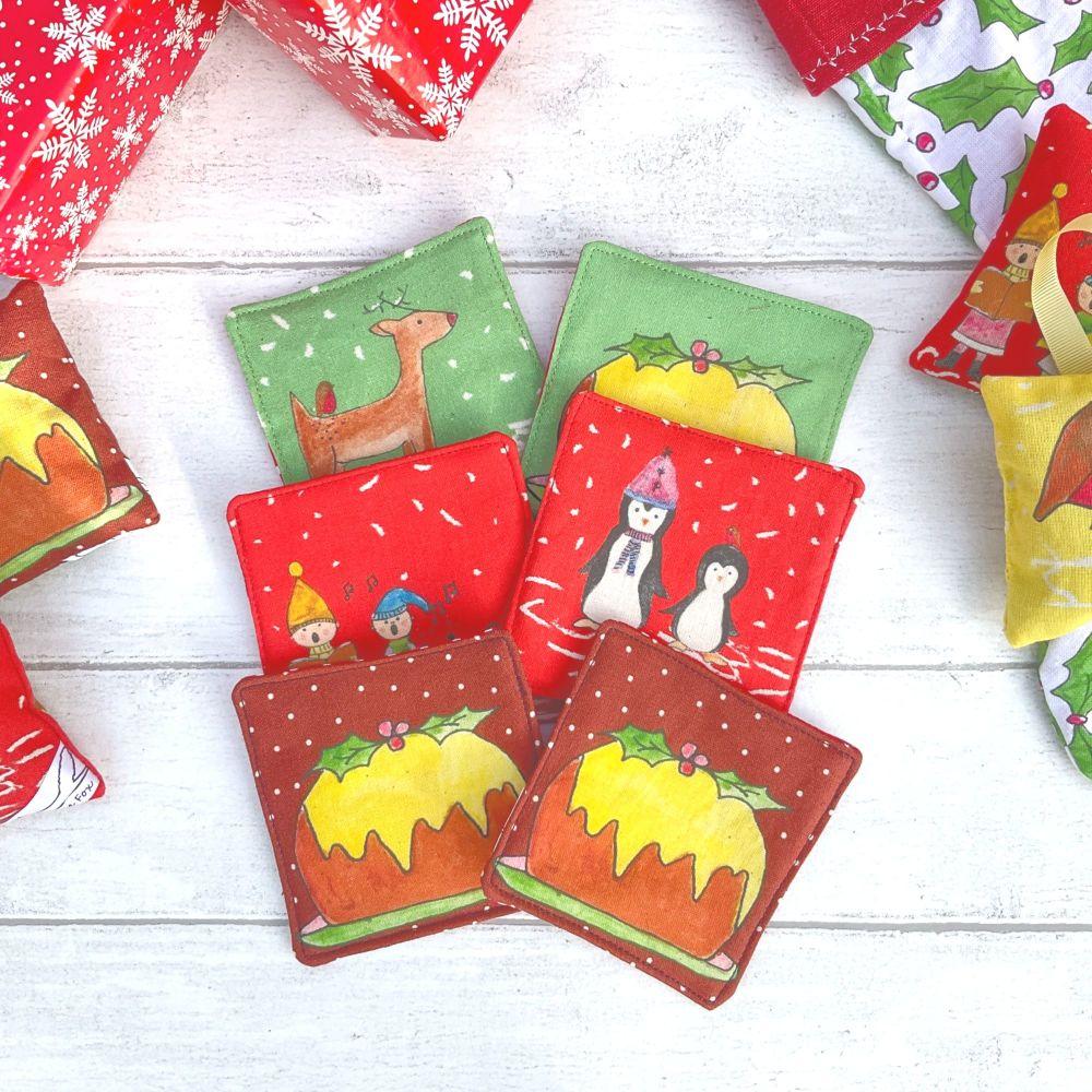 Pair of Christmas scene fabric coasters