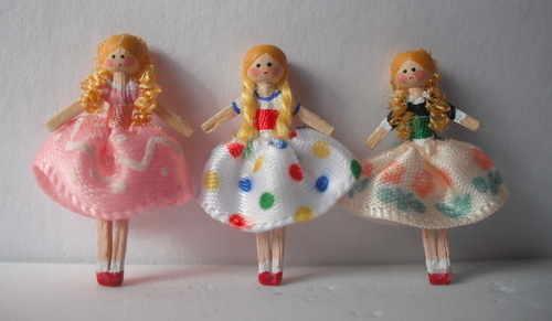 Dressed wooden dolls