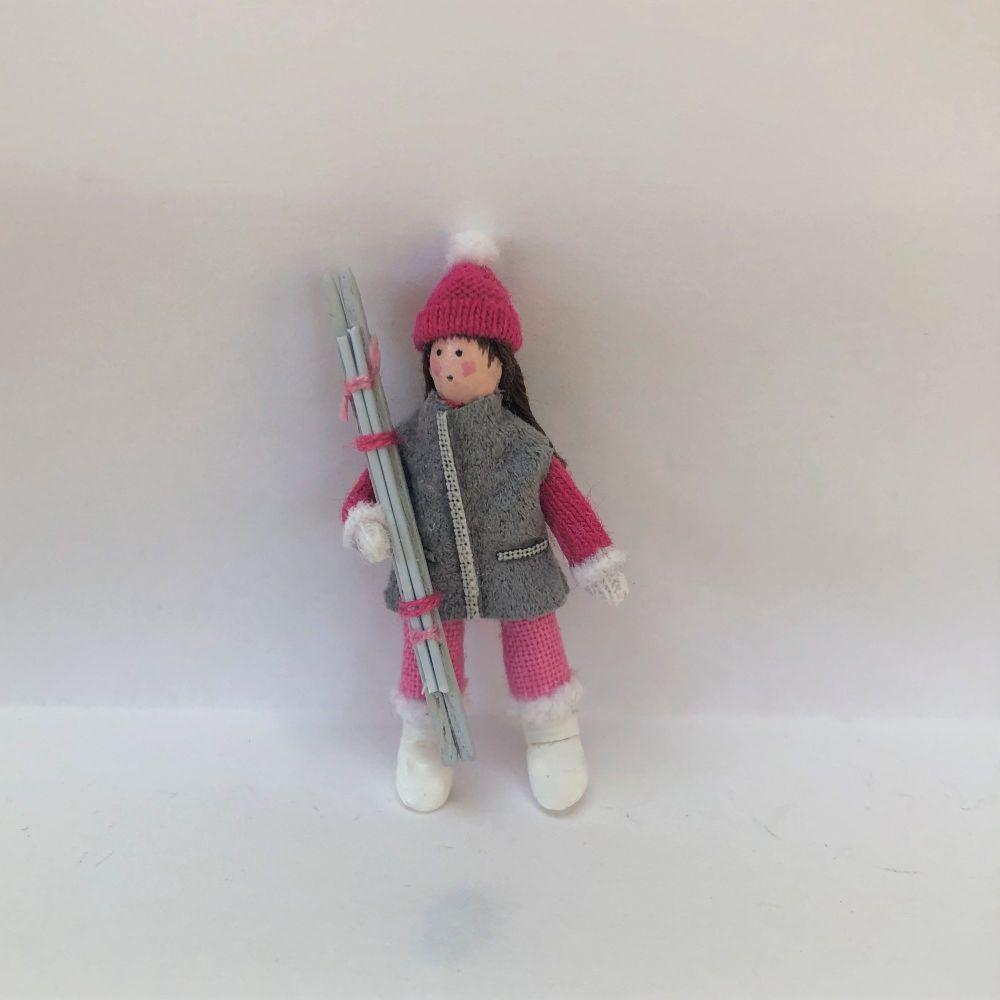 Woman Skier in Fuchsia Pink