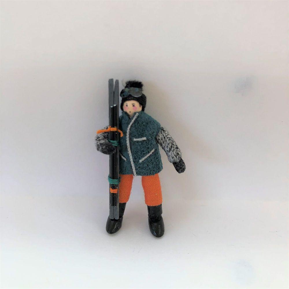 Male Skier green jacket