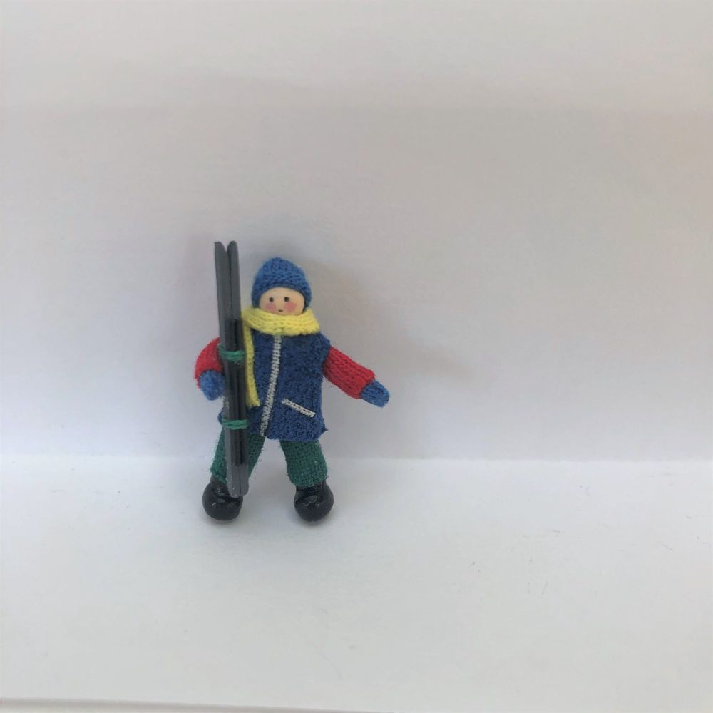 Boy Skier in royal blue jacket