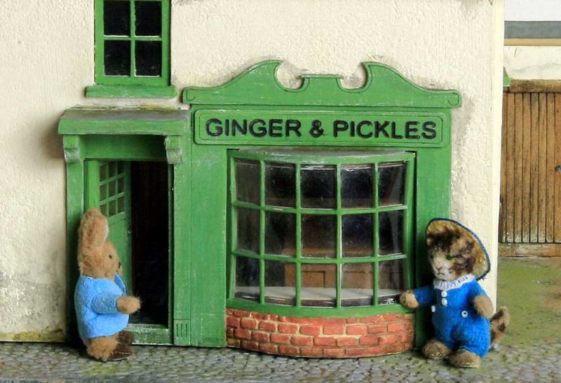 Peter Rabbit and Tom Kitten outside the Ginger and Pickles Shop