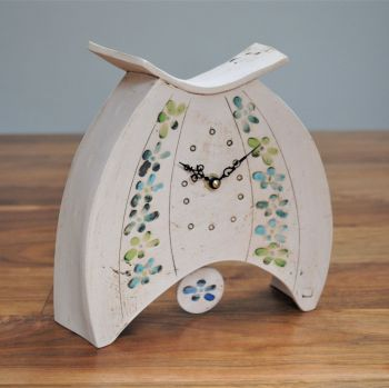 ceramic mantel clock rounded with pendulum