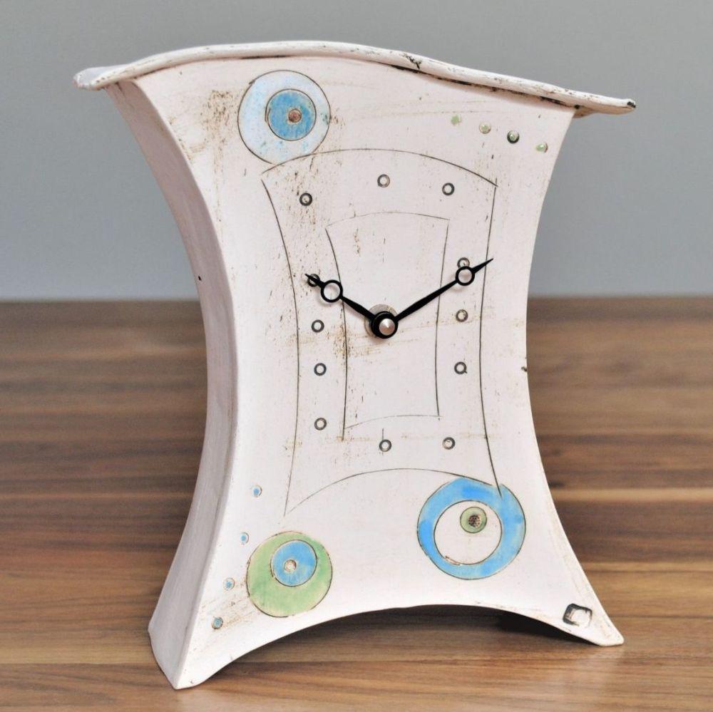 Medium ceramic mantel clock with blue and green circles.