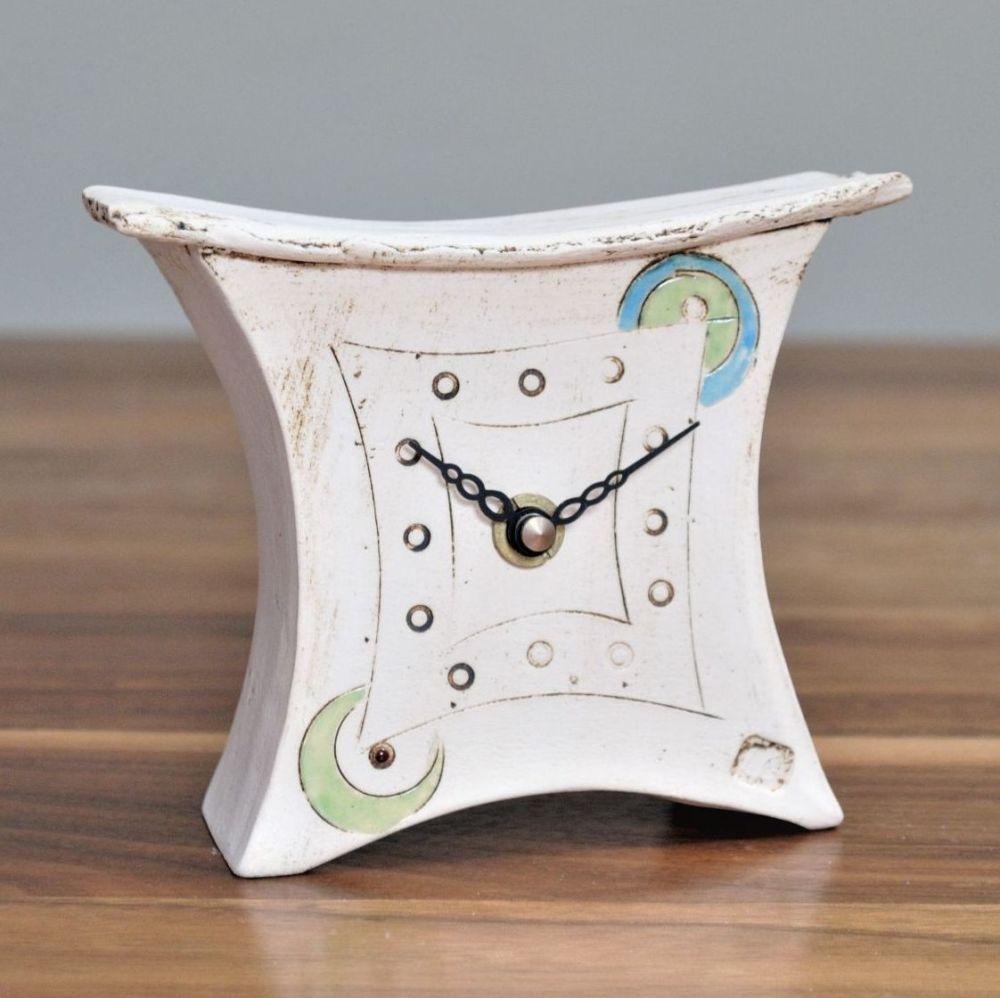 Handmade ceramic mantel clock with green and blue design.