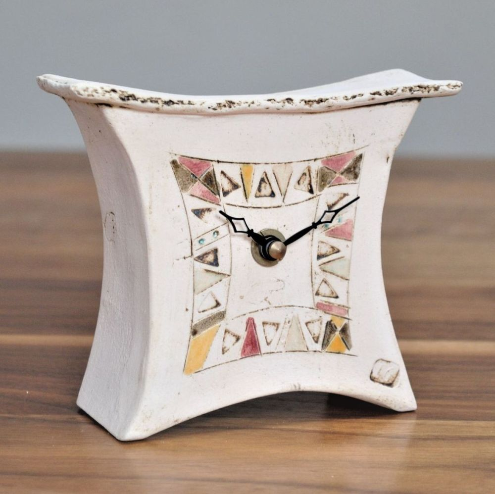 Handmade ceramic small clock decorated in contemporary design with red, yel