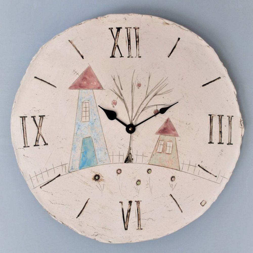 Handmade oversized ceramic wall clock round with house, tree a