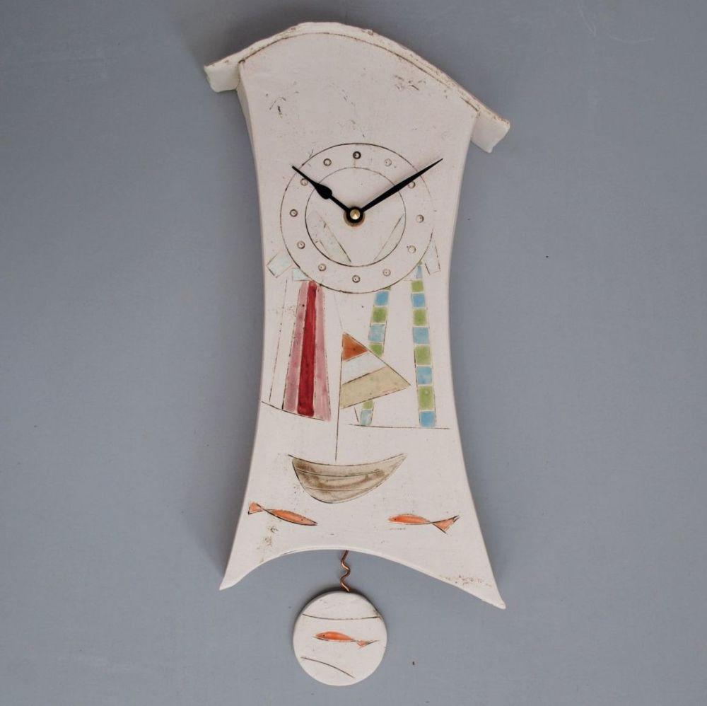 Handmade ceramic pendulum wall clock decorated with boat, fish and beach hu