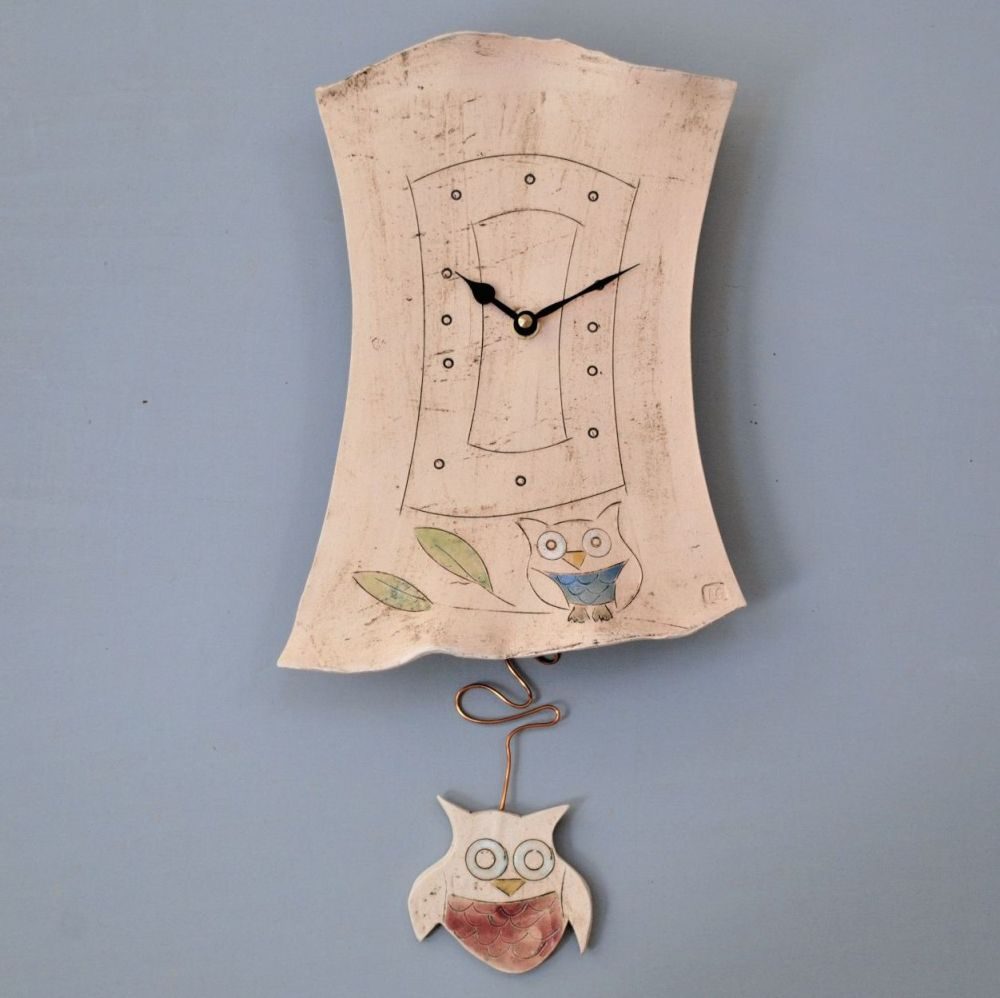 Handmade ceramic pendulum wall clock with owl design.