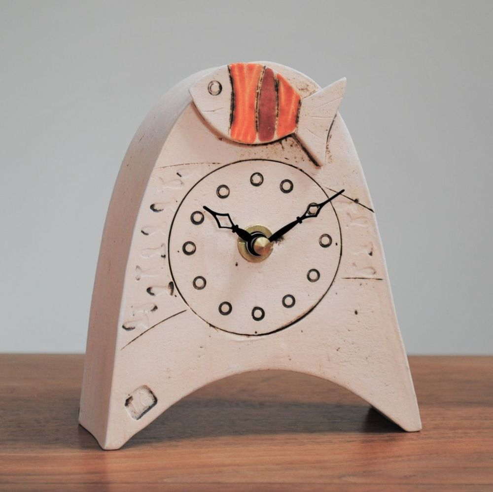 Handmade ceramic small mantel clock from white clay with fish design on the