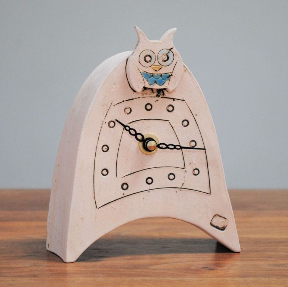 Ceramic mantel clock handmade from white clay with blue owl design on the f