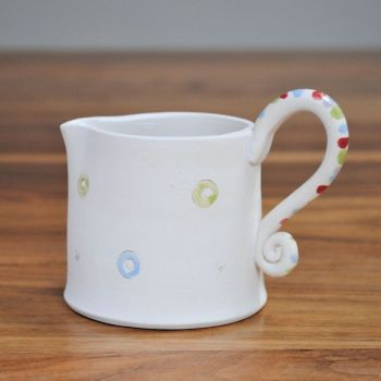 Jug with multicolor handle
