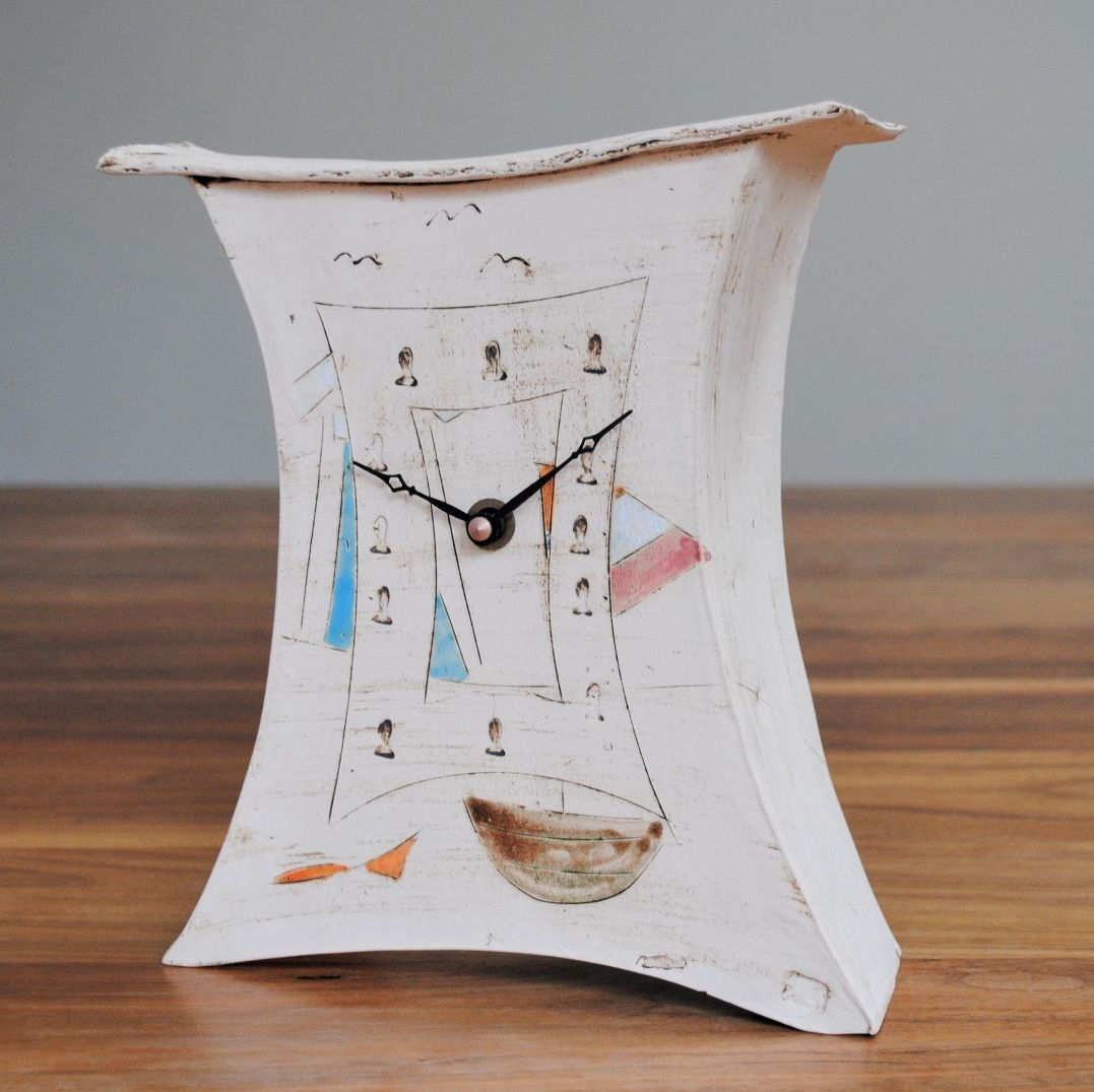 Handmade ceramic mantel clock decorated with sailing boat and a beach hut.